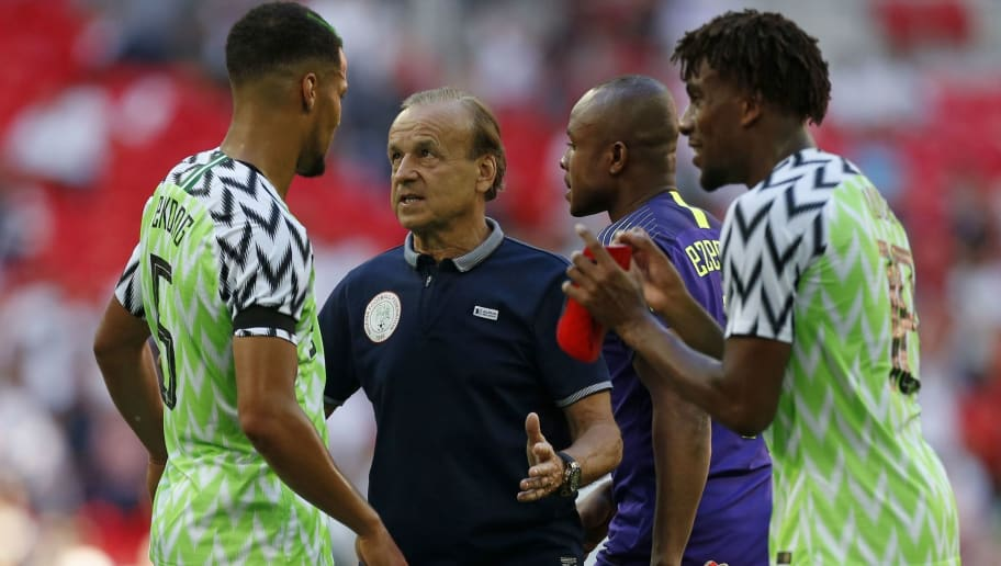 e8aee719b Nigeria s German manager Gernot Rohr (C) speaks to his players on the pitch  after