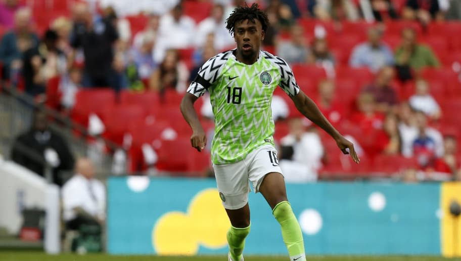 Nigeria's midfielder Alex Iwobi runs with the ball during the International friendly football match between England and Nigeria at Wembley stadium in London on June 2, 2018. (Photo by Ian KINGTON / AFP)        (Photo credit should read IAN KINGTON/AFP/Getty Images)