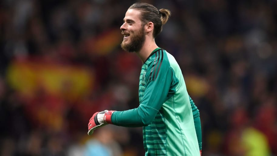 Spain's goalkeeper David de Gea reacts after Spain scored a goal during a friendly football match between Spain and Argentina at the Wanda Metropolitano Stadium in Madrid on March 27, 2018. / AFP PHOTO / GABRIEL BOUYS        (Photo credit should read GABRIEL BOUYS/AFP/Getty Images)