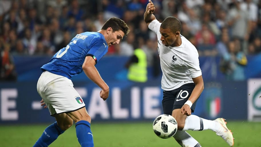 France's foward Kylian Mbappe (R) vies for the ball with Italy's defender Mattia Caldara  during the friendly football match between France and Italy at the Allianz Riviera Stadium in Nice, southeastern France, on June 1, 2018. (Photo by FRANCK FIFE / AFP)        (Photo credit should read FRANCK FIFE/AFP/Getty Images)