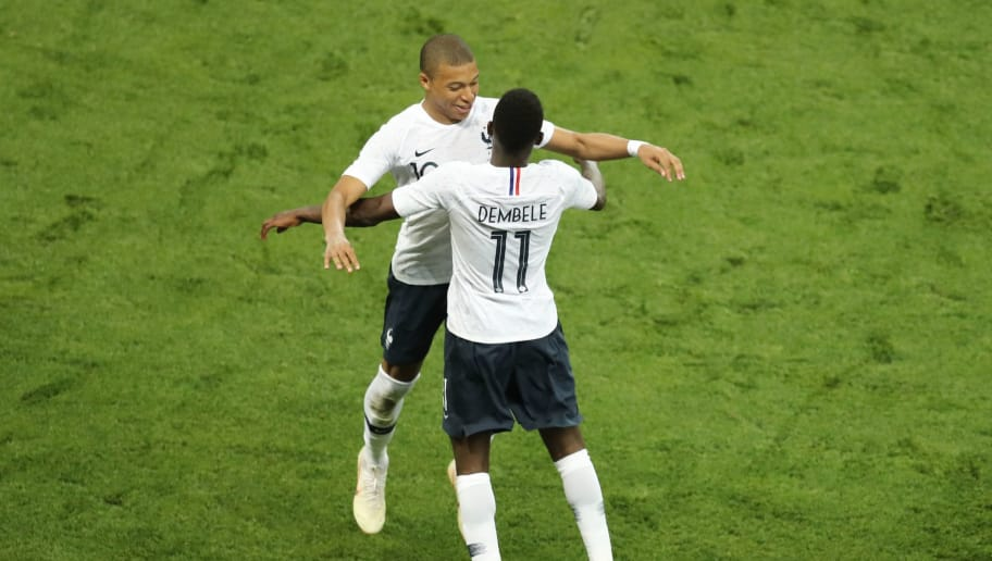 France's foward Ousmane Dembele (R) celebrates with France's foward Kylian Mbappe after scoring a goal during the friendly football match between France and Italy at the Allianz Riviera Stadium in Nice, southeastern France, on June 1, 2018. (Photo by VALERY HACHE / AFP)        (Photo credit should read VALERY HACHE/AFP/Getty Images)
