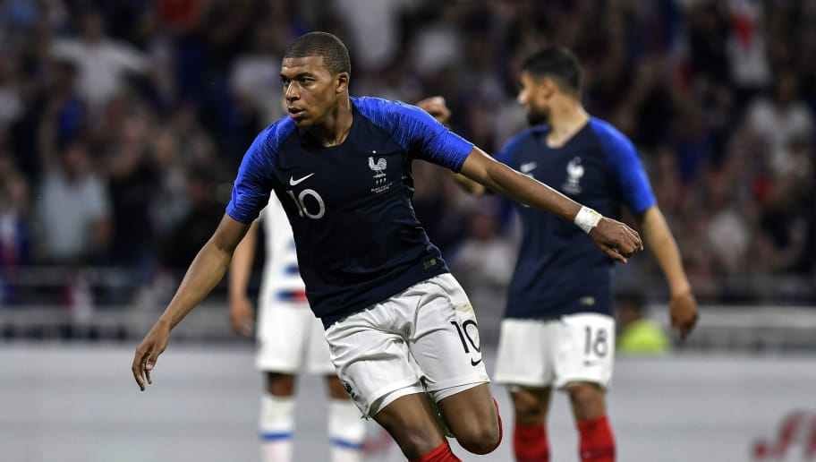 France's forward Kylian MBappe celebrates after scoring a goal during the friendly football match between France and USA at the at the Parc Olympique lyonnais stadium in Decines-Charpieu, near Lyon on June 9, 2018. (Photo by JEFF PACHOUD / AFP)        (Photo credit should read JEFF PACHOUD/AFP/Getty Images)