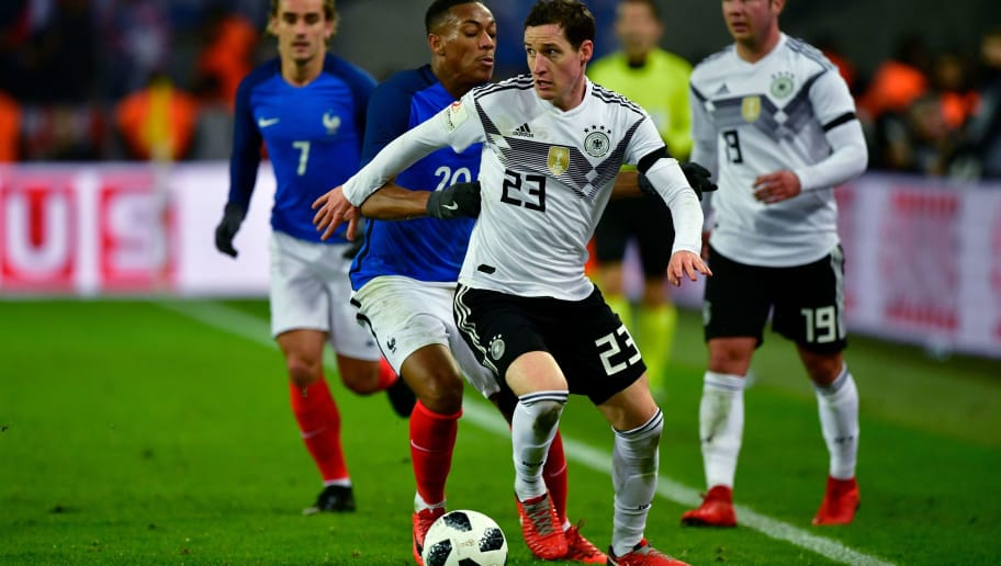 Germany's midfielder Sebastian Rudy (R) and France's forward Anthony Martial vie for the ball during the international friendly football match Germany against France in Cologne on November 14, 2017.  The match ended 2-2. / AFP PHOTO / John MACDOUGALL        (Photo credit should read JOHN MACDOUGALL/AFP/Getty Images)