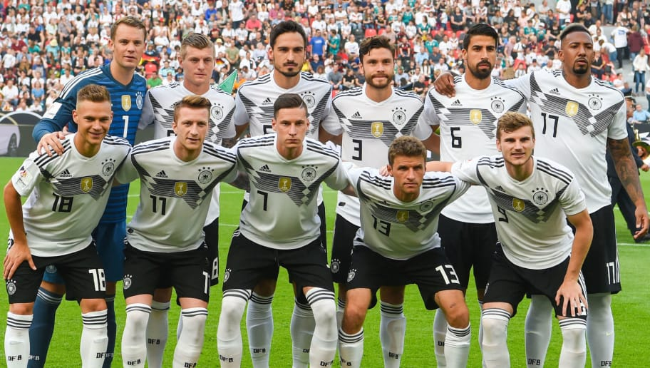 Germany's players pose for a team picture prior to the international friendly football match between Germany and Saudi Arabia at the BayArena stadium in Leverkusen, western Germany, on June 8, 2018: (front row, L-R): Germany's midfielder Joshua Kimmich, Germany's forward Marco Reus, Germany's midfielder Julian Draxler, Germany's forward Thomas Mueller and Germany's striker Timo Werner and (row behind, L-R): Germany's goalkeeper Manuel Neuer, Germany's midfielder Toni Kroos, Germany's defender Mats Hummels, Germany's defender Jonas Hector, Germany's midfielder Sami Khedira and Germany's defender Jerome Boateng. (Photo by Patrik STOLLARZ / AFP)        (Photo credit should read PATRIK STOLLARZ/AFP/Getty Images)