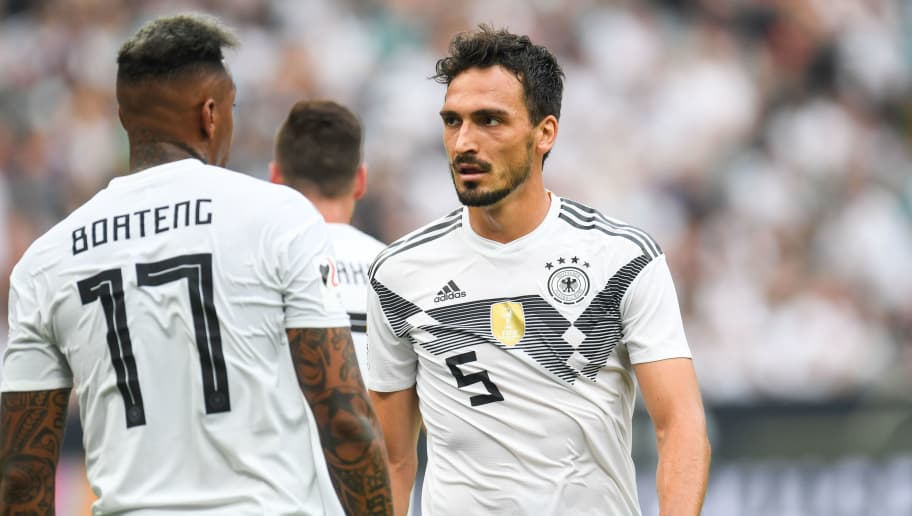 Germany's defender Mats Hummels and Germany's defender Jerome Boateng (L) react during the international friendly football match between Germany and Saudi Arabia at the BayArena stadium in Leverkusen, western Germany, on June 8, 2018. (Photo by Patrik STOLLARZ / AFP)        (Photo credit should read PATRIK STOLLARZ/AFP/Getty Images)