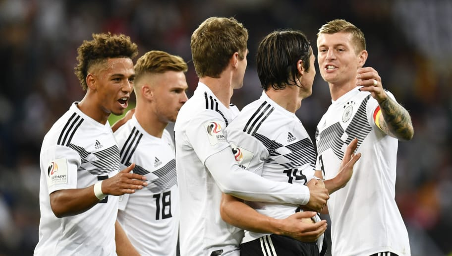 Germany's midfielder Toni Kroos (R) congratulates defender Nico Schulz (2nd R) after he scored his team's 2nd goal during the international friendly football match Germany vs Peru at the Rhein-Neckar-Arena in Sinsheim, southwestern Germany, on September 9, 2018. (Photo by THOMAS KIENZLE / AFP) / DFB REGULATIONS PROHIBIT ANY USE OF PHOTOGRAPHS AS IMAGE SEQUENCES AND QUASI-VIDEO.        (Photo credit should read THOMAS KIENZLE/AFP/Getty Images)