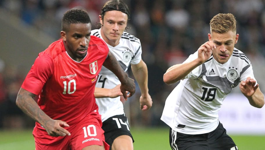 Germany's defender Joshua Kimmich (R) and Peru's forward Jefferson Farfan vie for the ball during the international friendly football match Germany versus Peru on September 9, 2018, at the Rhein-Neckar-Arena in Sinsheim, southwestern Germany. (Photo by Daniel ROLAND / AFP) / DFB REGULATIONS PROHIBIT ANY USE OF PHOTOGRAPHS AS IMAGE SEQUENCES AND QUASI-VIDEO.        (Photo credit should read DANIEL ROLAND/AFP/Getty Images)
