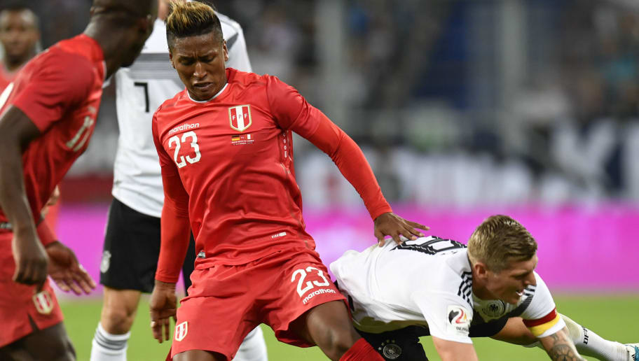 Germany's  midfielder Toni Kroos (R) and Peru's midfielder Pedro Aquino vie for the ball during the international friendly football match Germany vs Peru at the Rhein-Neckar-Arena in Sinsheim, southwestern Germany, on September 9, 2018. (Photo by THOMAS KIENZLE / AFP) / DFB REGULATIONS PROHIBIT ANY USE OF PHOTOGRAPHS AS IMAGE SEQUENCES AND QUASI-VIDEO.        (Photo credit should read THOMAS KIENZLE/AFP/Getty Images)