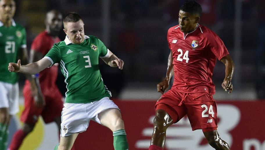 Panama's Miguel Camargo (R) vies for the ball with Shane Ferguson from Northern Ireland during their international friendly football match between Panama and Northern Ireland at Rommel Fernandez Stadium on May 29, 2018 in Panama City. (Photo by RODRIGO ARANGUA / AFP)        (Photo credit should read RODRIGO ARANGUA/AFP/Getty Images)