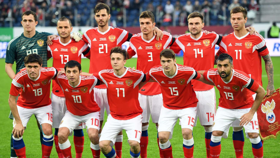 back row from L: Russia's goalkeeper Andrey Lunyov, Russia's defender Fyodor Kudryashov, Russia's midfielder Aleksandr Erokhin, Russia's defender Roman Neustaedter, Russia's defender Vladimir Granat, Russia's forward Fyodor Smolov, front row from L: Russia's midfielder Yuri Zhirkov, Russia's midfielder Alan Dzagoev, Russia's midfielder Alexander Golovin, Russia's midfielder Aleksey Miranchuk and Russia's midfielder Alexander Samedov pose for a team picture prior to an international friendly football match between Russia and France at the Saint Petersburg Stadium in Saint Petersburg on March 27, 2018. / AFP PHOTO / Kirill KUDRYAVTSEV        (Photo credit should read KIRILL KUDRYAVTSEV/AFP/Getty Images)