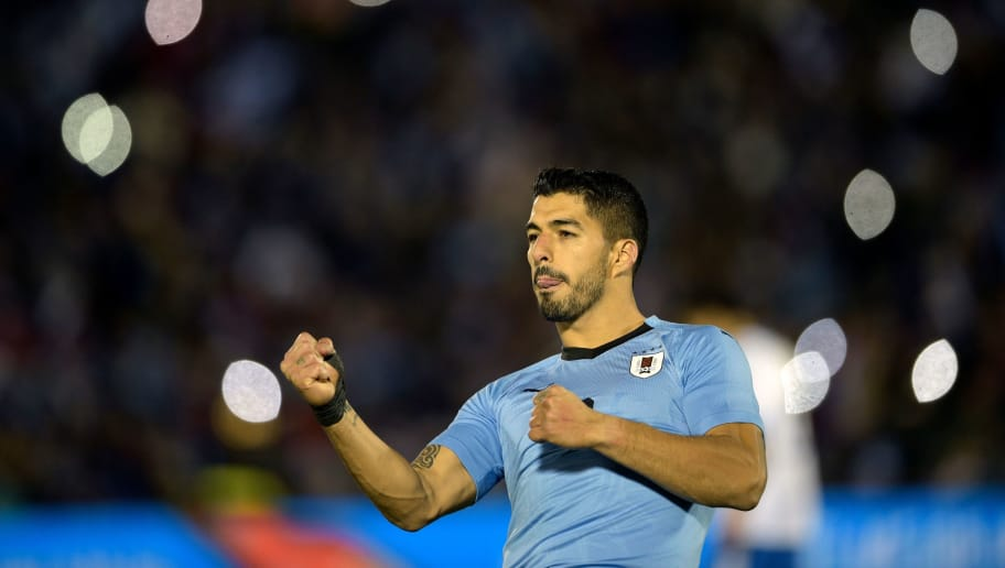 Uruguay's Luis Suarez celebrates after scoring during the international friendly football match between Uruguay and Uzbekistan at the Centenario stadium in Montevideo, on June 7, 2018. (Photo by Miguel Rojo / AFP)        (Photo credit should read MIGUEL ROJO/AFP/Getty Images)