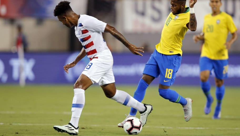 Brazil's midfielder Fred (R) vies for the ball against US midfielder Weston Mckennie during their friendly match at the Metlife Stadium in East Rutherford, New Jersey on September 7, 2018 (Photo by EDUARDO MUNOZ ALVAREZ / AFP)        (Photo credit should read EDUARDO MUNOZ ALVAREZ/AFP/Getty Images)