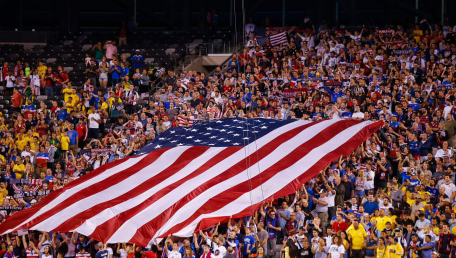 US fans cheer their team during their friendly football match against the Brazil at the Metlife Stadium in East Rutherford, New Jersey on September 7, 2018. (Photo by EDUARDO MUNOZ ALVAREZ / AFP)        (Photo credit should read EDUARDO MUNOZ ALVAREZ/AFP/Getty Images)