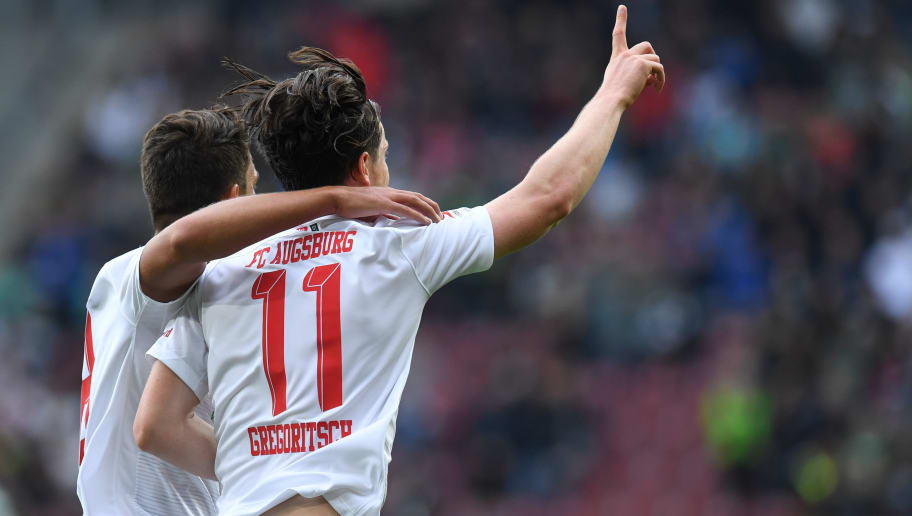 Augsburg's Austrian midfielder Michael Gregoritsch (R) is congratulated by teammate Augsburg's German midfielder Rani Khedira after scoring the 1-0 during the German first division Bundesliga football match FC Augsburg vs Borussia Moenchengladbach in Augsburg, southern Germany, on September 1, 2018. (Photo by Christof STACHE / AFP) / RESTRICTIONS: DFL REGULATIONS PROHIBIT ANY USE OF PHOTOGRAPHS AS IMAGE SEQUENCES AND/OR QUASI-VIDEO        (Photo credit should read CHRISTOF STACHE/AFP/Getty Images)