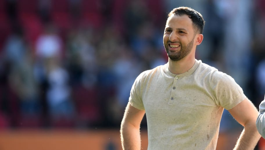 Schalke's German-Italian headchoach Domenico Tedesco reacts after the German first division Bundesliga football match FC Augsburg vs Schalke 04 in Augsburg, southern Germany, on May 5, 2018. (Photo by Christof STACHE / AFP) / RESTRICTIONS: DURING MATCH TIME: DFL RULES TO LIMIT THE ONLINE USAGE TO 15 PICTURES PER MATCH AND FORBID IMAGE SEQUENCES TO SIMULATE VIDEO. == RESTRICTED TO EDITORIAL USE == FOR FURTHER QUERIES PLEASE CONTACT DFL DIRECTLY AT + 49 69 650050        (Photo credit should read CHRISTOF STACHE/AFP/Getty Images)