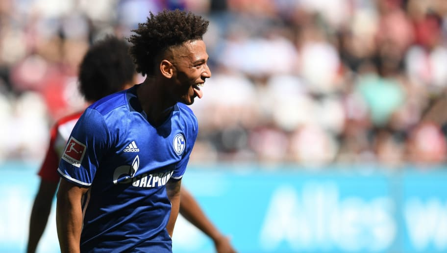 Schalke's German defender Thilo Kehrer celebrates after scoring the first goal during the German first division Bundesliga football match FC Augsburg vs Schalke 04 in Augsburg, southern Germany, on May 5, 2018. (Photo by Christof STACHE / AFP) / RESTRICTIONS: DURING MATCH TIME: DFL RULES TO LIMIT THE ONLINE USAGE TO 15 PICTURES PER MATCH AND FORBID IMAGE SEQUENCES TO SIMULATE VIDEO. == RESTRICTED TO EDITORIAL USE == FOR FURTHER QUERIES PLEASE CONTACT DFL DIRECTLY AT + 49 69 650050        (Photo credit should read CHRISTOF STACHE/AFP/Getty Images)