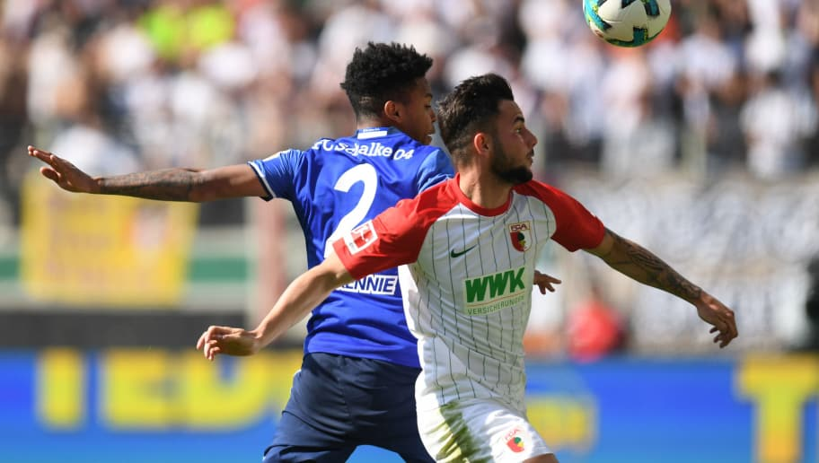 Augsburg's midfielder Marco Richter (R) and Schalke's US midfielder Weston McKennie (L) vie for the ball during the German first division Bundesliga football match FC Augsburg vs Schalke 04 in Augsburg, southern Germany, on May 5, 2018. (Photo by Christof STACHE / AFP) / RESTRICTIONS: DURING MATCH TIME: DFL RULES TO LIMIT THE ONLINE USAGE TO 15 PICTURES PER MATCH AND FORBID IMAGE SEQUENCES TO SIMULATE VIDEO. == RESTRICTED TO EDITORIAL USE == FOR FURTHER QUERIES PLEASE CONTACT DFL DIRECTLY AT + 49 69 650050        (Photo credit should read CHRISTOF STACHE/AFP/Getty Images)