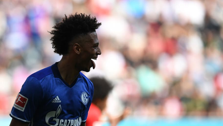Schalke's German defender Thilo Kehrer reacts after scoring the 0-1 during the German first division Bundesliga football match FC Augsburg vs Schalke 04 in Augsburg, southern Germany, on May 5, 2018. (Photo by Christof STACHE / AFP) / RESTRICTIONS: DURING MATCH TIME: DFL RULES TO LIMIT THE ONLINE USAGE TO 15 PICTURES PER MATCH AND FORBID IMAGE SEQUENCES TO SIMULATE VIDEO. == RESTRICTED TO EDITORIAL USE == FOR FURTHER QUERIES PLEASE CONTACT DFL DIRECTLY AT + 49 69 650050        (Photo credit should read CHRISTOF STACHE/AFP/Getty Images)