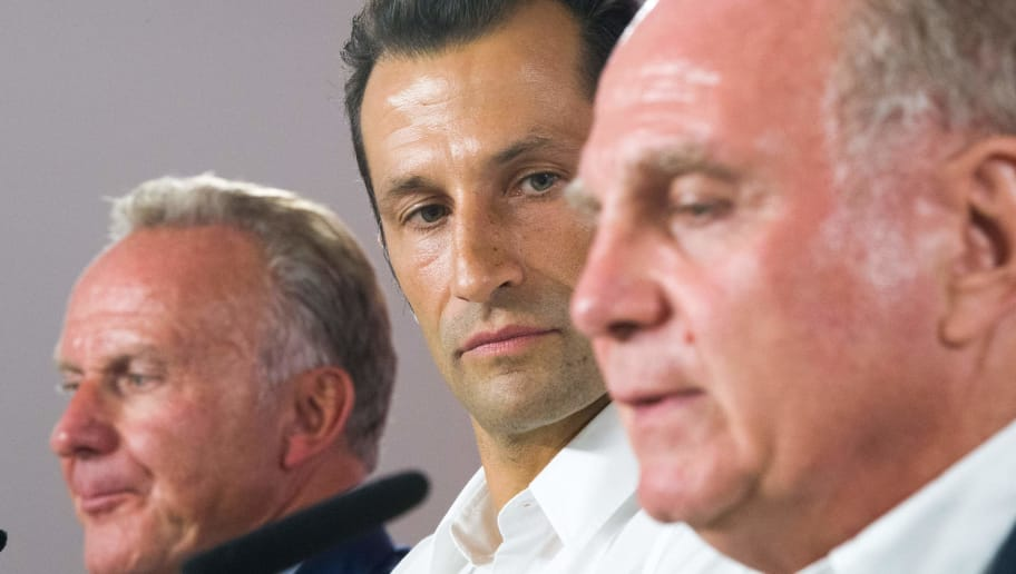Hasan Salihamidzic is presented as FC Bayern Munich's new sports director by FC Bayern Munich President, Uli Hoeness (R), and FC Bayern Munich's Chairman, Karl-Heinz Rummenige (L), in Munich, Germany, on July 31, 2017 / AFP PHOTO / dpa / Peter Kneffel / Germany OUT        (Photo credit should read PETER KNEFFEL/AFP/Getty Images)