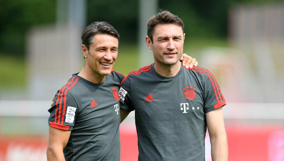 Bayern Munich's new Croatian head coach Niko Kovac (L) and his brother and assistant coach Robert Kovac (R) pose prior a trainings session at the FC Bayern Munich trainings ground in Munich, southern Germany, on July 4, 2018. (Photo by Christof STACHE / AFP)        (Photo credit should read CHRISTOF STACHE/AFP/Getty Images)