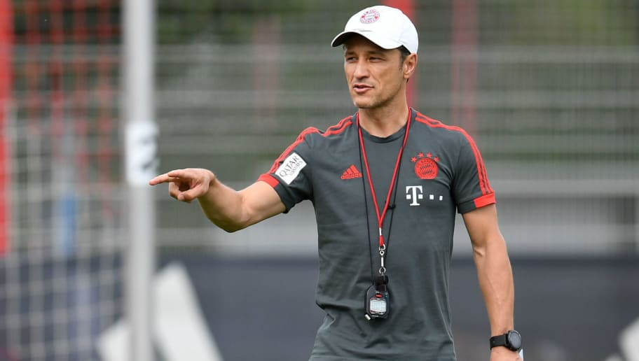 Bayern Munich's new Croatian head coach Niko Kovac (R) gestures next to Brazilian defender Rafinha (L) during a training's session at the FC Bayern Munich trainings ground in Munich, southern Germany, on July 4, 2018. (Photo by Christof STACHE / AFP)        (Photo credit should read CHRISTOF STACHE/AFP/Getty Images)