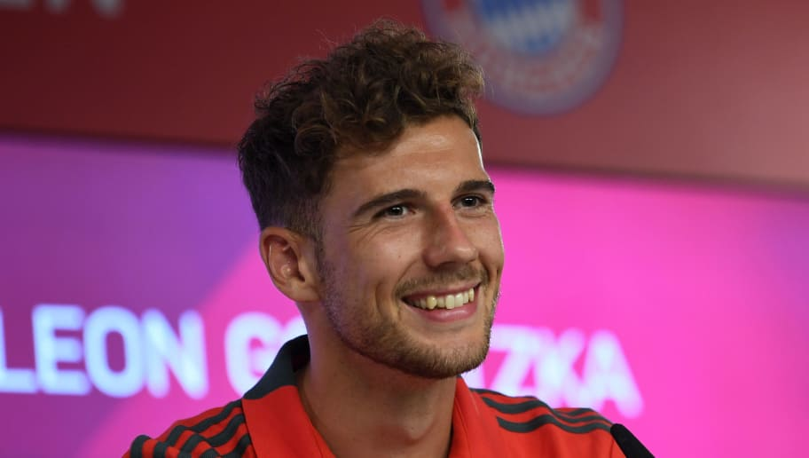 Bayern Munich's new midfielder Leon Goretzka smiles during a press conference for his official presentation on August 2, 2018 at the Bayern Munich's club area in Munich, southern Germany. (Photo by Christof STACHE / AFP)        (Photo credit should read CHRISTOF STACHE/AFP/Getty Images)