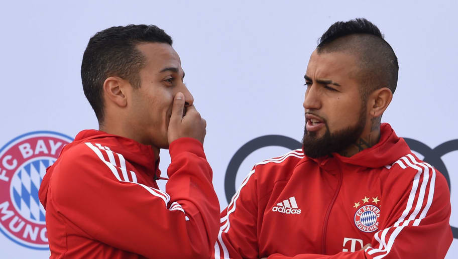 Bayern Munich's Chilean midfielder Arturo Vidal (R) talks with Bayern Munich's Spanish midfielder Thiago Alcantara during a car handover event at the Audi headquarters in Ingolstadt, southern Germany, on October 11, 2017.  / AFP PHOTO / Christof STACHE        (Photo credit should read CHRISTOF STACHE/AFP/Getty Images)