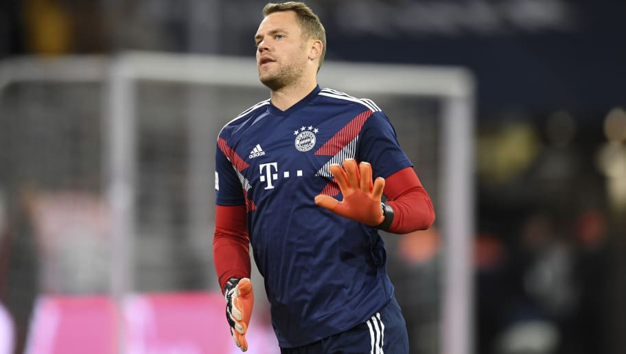 Bayern Munich's German goalkeeper Manuel Neuer warms up prior to the German first division Bundesliga match between FC Bayern Munich and FC Augsburg in the stadium in Munich, southern Germany, on September 25, 2018. (Photo by Christof STACHE / AFP)        (Photo credit should read CHRISTOF STACHE/AFP/Getty Images)