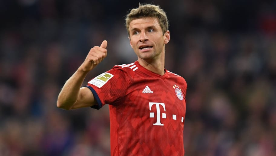 Bayern Munich's striker Thomas Mueller reacts during the German first division Bundesliga football match FC Bayern Munich v FC Augsburg at the Allianz Arena in Munich, southern Germany on September 25, 2018. (Photo by Christof STACHE / AFP) / RESTRICTIONS: DFL REGULATIONS PROHIBIT ANY USE OF PHOTOGRAPHS AS IMAGE SEQUENCES AND/OR QUASI-VIDEO        (Photo credit should read CHRISTOF STACHE/AFP/Getty Images)
