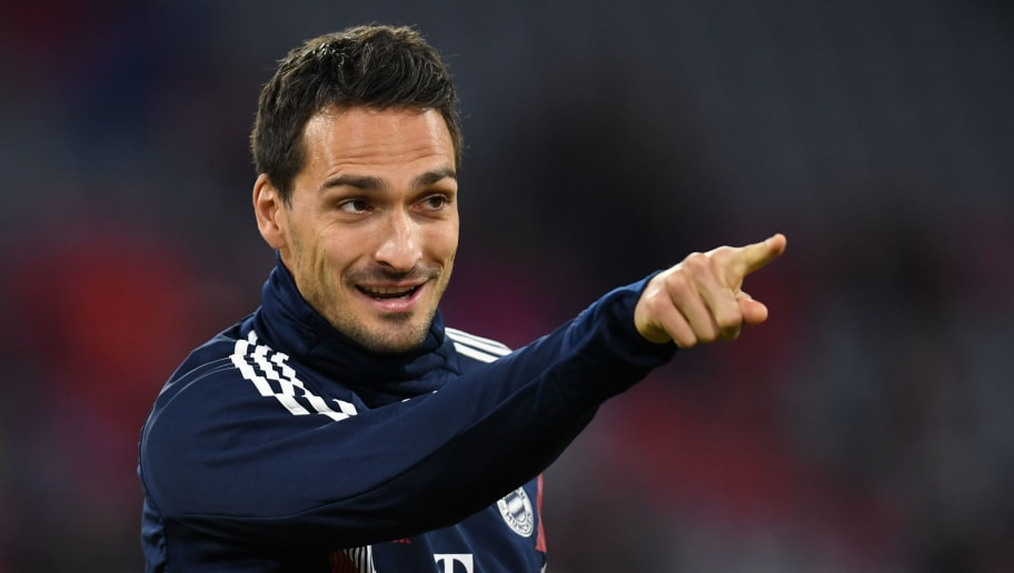 Bayern Munich's defender Mats Hummels gestures during the warm up prior  the German first division Bundesliga match between FC Bayern Munich and FC Augsburg in the stadium in Munich, southern Germany, on September 25, 2018. (Photo by Christof STACHE / AFP)        (Photo credit should read CHRISTOF STACHE/AFP/Getty Images)