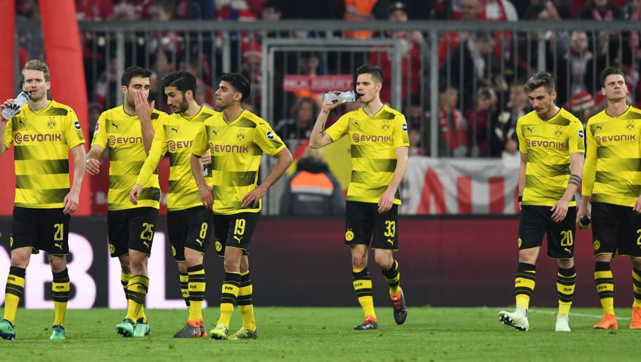 (LtoR) Dortmund's German midfielder Andre Schuerrle, Dortmund's Greece defender Sokratis, Dortmund's Turkish midfielder Nuri Sahin, Dortmund's German midfielder Mahmoud Dahoud, Dortmund's German midfielder Julian Weigl, Dortmund's German forward Maximilian Philipp and Dortmund's Polish defender Lukasz Piszczek leave the pitch after  the German first division Bundesliga football match FC Bayern Munich vs Borussia Dortmund in Munich, southern Germany, on March 31, 2018.  Munich won the match 6-0. / AFP PHOTO / Christof STACHE / RESTRICTIONS: DURING MATCH TIME: DFL RULES TO LIMIT THE ONLINE USAGE TO 15 PICTURES PER MATCH AND FORBID IMAGE SEQUENCES TO SIMULATE VIDEO. == RESTRICTED TO EDITORIAL USE == FOR FURTHER QUERIES PLEASE CONTACT DFL DIRECTLY AT + 49 69 650050  / RESTRICTIONS: DURING MATCH TIME: DFL RULES TO LIMIT THE ONLINE USAGE TO 15 PICTURES PER MATCH AND FORBID IMAGE SEQUENCES TO SIMULATE VIDEO. == RESTRICTED TO EDITORIAL USE == FOR FURTHER QUERIES PLEASE CONTACT DFL DIRECTLY AT + 49 69 650050        (Photo credit should read CHRISTOF STACHE/AFP/Getty Images)
