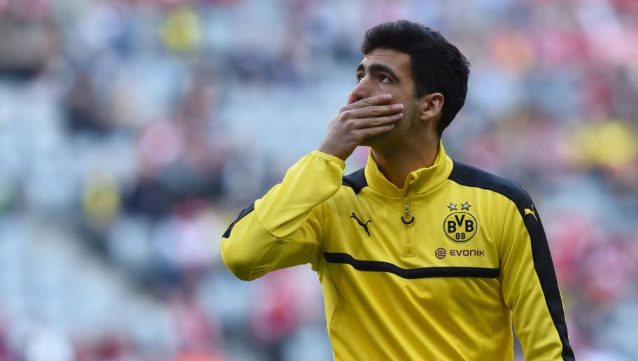 Dortmund's Spanish midfielder Mikel Merino is pictured during the warm-up prior to the German first division Bundesliga football match FC Bayern Munich v BVB Borussia Dortmund in Munich, southern Germany, on April 8, 2017. / AFP PHOTO / Christof STACHE / RESTRICTIONS: DURING MATCH TIME: DFL RULES TO LIMIT THE ONLINE USAGE TO 15 PICTURES PER MATCH AND FORBID IMAGE SEQUENCES TO SIMULATE VIDEO. == RESTRICTED TO EDITORIAL USE == FOR FURTHER QUERIES PLEASE CONTACT DFL DIRECTLY AT + 49 69 650050         (Photo credit should read CHRISTOF STACHE/AFP/Getty Images)