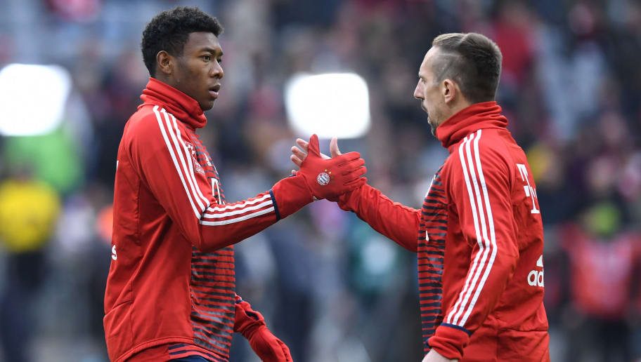 Bayern Munich's Austrian defender David Alaba (L) and Bayern Munich's French midfielder Franck Ribery (R) greet each other prior to the German first division Bundesliga football match FC Bayern Munich vs Borussia Dortmund in Munich, southern Germany, on March 31, 2018.  / AFP PHOTO / Christof STACHE / RESTRICTIONS: DURING MATCH TIME: DFL RULES TO LIMIT THE ONLINE USAGE TO 15 PICTURES PER MATCH AND FORBID IMAGE SEQUENCES TO SIMULATE VIDEO. == RESTRICTED TO EDITORIAL USE == FOR FURTHER QUERIES PLEASE CONTACT DFL DIRECTLY AT + 49 69 650050  / RESTRICTIONS: DURING MATCH TIME: DFL RULES TO LIMIT THE ONLINE USAGE TO 15 PICTURES PER MATCH AND FORBID IMAGE SEQUENCES TO SIMULATE VIDEO. == RESTRICTED TO EDITORIAL USE == FOR FURTHER QUERIES PLEASE CONTACT DFL DIRECTLY AT + 49 69 650050        (Photo credit should read CHRISTOF STACHE/AFP/Getty Images)
