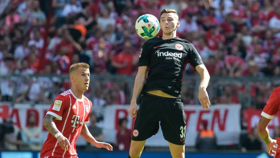 Frankfurt's Swedish striker Branimir Hrgota (C) vies for the ball with Bayern Munich's German midfielder Niklas Dorsch (L) and Bayern Munich's French midfielder Corentin Tolisso (R) during the German first division Bundesliga football match FC Bayern Munich vs Eintracht Frankfurt in Munich, southern Germany on April 28, 2018. (Photo by Guenter SCHIFFMANN / AFP) / RESTRICTIONS: DURING MATCH TIME: DFL RULES TO LIMIT THE ONLINE USAGE TO 15 PICTURES PER MATCH AND FORBID IMAGE SEQUENCES TO SIMULATE VIDEO. == RESTRICTED TO EDITORIAL USE == FOR FURTHER QUERIES PLEASE CONTACT DFL DIRECTLY AT + 49 69 650050        (Photo credit should read GUENTER SCHIFFMANN/AFP/Getty Images)