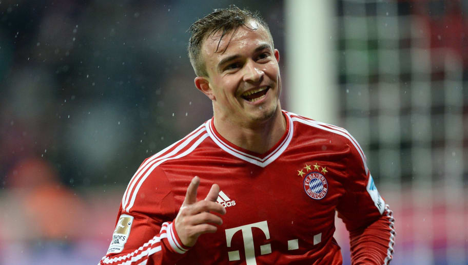 Bayern Munich's Swiss midfielder Xherdan Shaqiri celebrates after the third goal for Munich during the German first division Bundesliga football match between FC Bayern Munich and Hamburger SV on December 14, 2013 at the stadium in Munich, southern Germany. AFP PHOTO/CHRISTOF STACHE DFL RULES TO LIMIT THE ONLINE USAGE DURING MATCH TIME TO 15 PICTURES PER MATCH. FOR FURTHER QUERIES PLEASE CONTACT DFL DIRECTLY AT + 49 69 650050.        (Photo credit should read CHRISTOF STACHE/AFP/Getty Images)