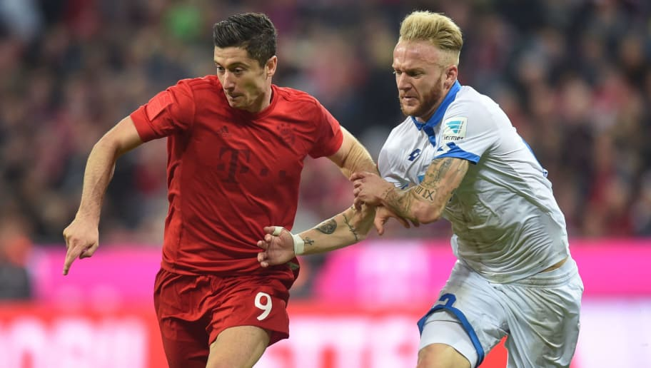 Bayern Munich's Polish forward Robert Lewandowski (L) and Hoffenheim's midfielder Kevin Vogt vie for the ball during the German first division Bundesliga football match between FC Bayern Munich and TSG 1899 Hoffenheim in Munich, southern Germany, on November 5, 2016.  / AFP / CHRISTOF STACHE / RESTRICTIONS: DURING MATCH TIME: DFL RULES TO LIMIT THE ONLINE USAGE TO 15 PICTURES PER MATCH AND FORBID IMAGE SEQUENCES TO SIMULATE VIDEO. == RESTRICTED TO EDITORIAL USE == FOR FURTHER QUERIES PLEASE CONTACT DFL DIRECTLY AT + 49 69 650050         (Photo credit should read CHRISTOF STACHE/AFP/Getty Images)
