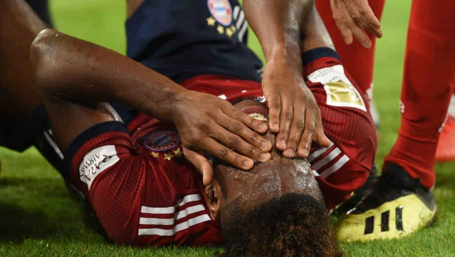 Bayern Munich's French forward Kingsley Coman receives medical attention during the German first division Bundesliga football match FC Bayern Munich v TSG 1899 Hoffenheim at the Allianz Arena in Munich, southern Germany on August 24, 2018. (Photo by Christof STACHE / AFP) / RESTRICTIONS: DFL REGULATIONS PROHIBIT ANY USE OF PHOTOGRAPHS AS IMAGE SEQUENCES AND/OR QUASI-VIDEO        (Photo credit should read CHRISTOF STACHE/AFP/Getty Images)