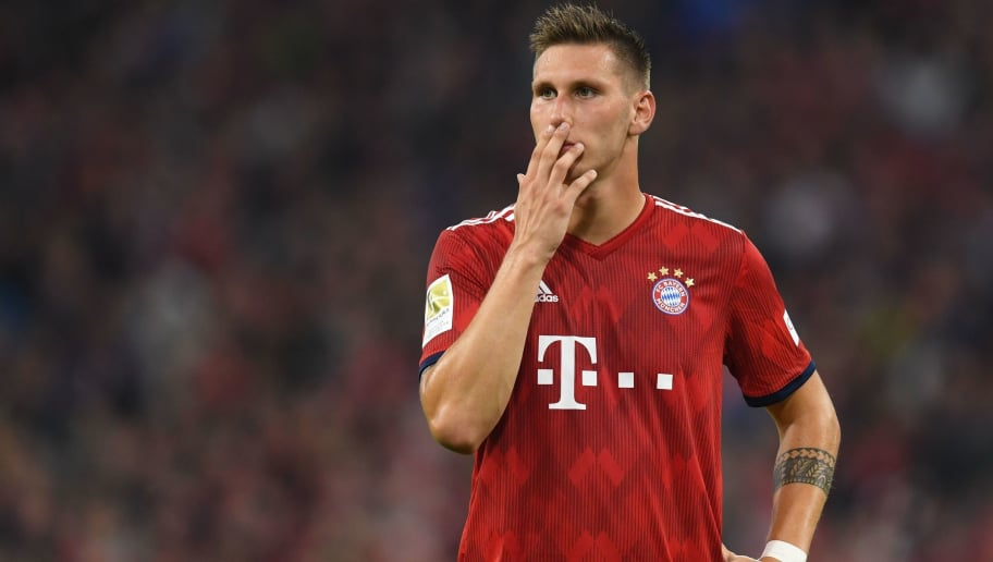 Bayern Munich's German defender Niklas Suele reacts during the German first division Bundesliga football match FC Bayern Munich v TSG 1899 Hoffenheim at the Allianz Arena in Munich, southern Germany on August 24, 2018. (Photo by Christof STACHE / AFP) / RESTRICTIONS: DFL REGULATIONS PROHIBIT ANY USE OF PHOTOGRAPHS AS IMAGE SEQUENCES AND/OR QUASI-VIDEO        (Photo credit should read CHRISTOF STACHE/AFP/Getty Images)