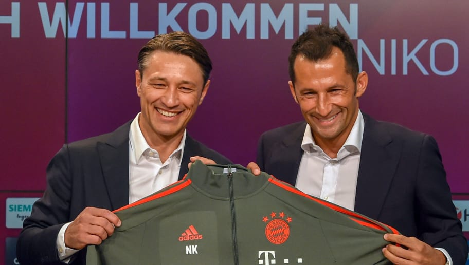 Bayern Munich's Croatian head coach Niko Kovac (L) and Bayern Munich's Croatian sports manager Hasan Salihamidzic (R) pose with the new trainers jacket during a press conference in the stadium in Munich, southern Germany, on July 2, 2018. - The former Eintracht coach Niko Kovac will take over from Jupp Heynckes for the 2018/2019 Bundesliga season. (Photo by Christof STACHE / AFP)        (Photo credit should read CHRISTOF STACHE/AFP/Getty Images)