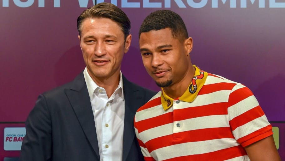 Bayern Munich's new head coach Croatian Niko Kovac (L) and midfielder Serge Gnabry pose during a press conference in the stadium in Munich, southern Germany, on July 2, 2018. - The former Eintracht Frankfurt coach Niko Kovac will take over from Jupp Heynckes for the 2018/2019 Bundesliga season. (Photo by Christof STACHE / AFP)        (Photo credit should read CHRISTOF STACHE/AFP/Getty Images)