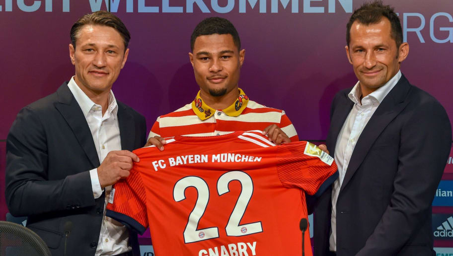 (L-R) Bayern Munich's new head coach Croatian Niko Kovac, midfielder Serge Gnabry and  Bayern Munich's Croatian sports manager Hasan Salihamidzic pose with Gnabry's new jersey during a press conference in the stadium in Munich, southern Germany, on July 2, 2018. - The former Eintracht Frankfurt coach Niko Kovac will take over from Jupp Heynckes for the 2018/2019 Bundesliga season. (Photo by Christof STACHE / AFP)        (Photo credit should read CHRISTOF STACHE/AFP/Getty Images)