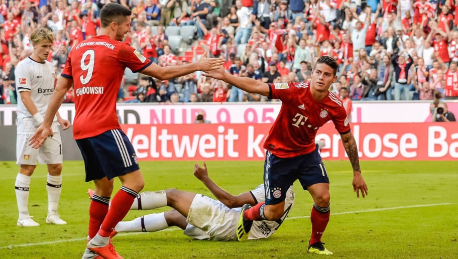 Bayern Munich's Columbian midfielder James Rodriguez (R) celebrates his goal  during the German First division Bundesliga football match between FC Bayern Munich and Bayer Leverkusen in Munich, on September 15, 2018. (Photo by Guenter SCHIFFMANN / AFP) / DFL REGULATIONS PROHIBIT ANY USE OF PHOTOGRAPHS AS IMAGE SEQUENCES AND/OR QUASI-VIDEO        (Photo credit should read GUENTER SCHIFFMANN/AFP/Getty Images)