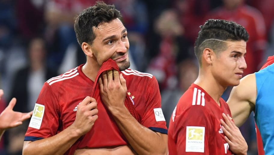 Bayern Munich's defender Mats Hummels (L) and Bayern Munich's Colombian James Rodriguez  react after the German first division Bundesliga football match FC Bayern Munich vs Borussia Moenchengladbach in Munich, southern Germany, on October 6, 2018. (Photo by Christof STACHE / AFP) / RESTRICTIONS: DFL REGULATIONS PROHIBIT ANY USE OF PHOTOGRAPHS AS IMAGE SEQUENCES AND/OR QUASI-VIDEO        (Photo credit should read CHRISTOF STACHE/AFP/Getty Images)