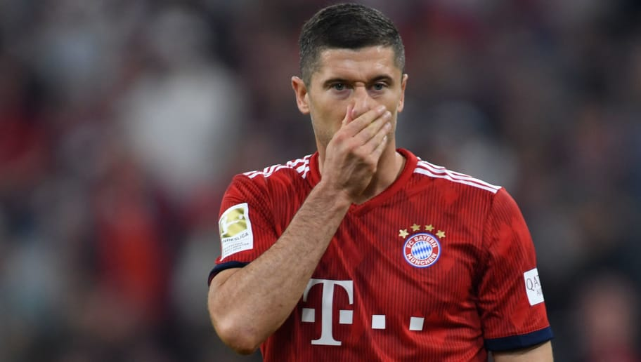Bayern Munich's Polish striker Robert Lewandowski wipes his nose during the German first division Bundesliga football match FC Bayern Munich vs Borussia Moenchengladbach in Munich, southern Germany, on October 6, 2018. (Photo by Christof STACHE / AFP) / RESTRICTIONS: DFL REGULATIONS PROHIBIT ANY USE OF PHOTOGRAPHS AS IMAGE SEQUENCES AND/OR QUASI-VIDEO        (Photo credit should read CHRISTOF STACHE/AFP/Getty Images)