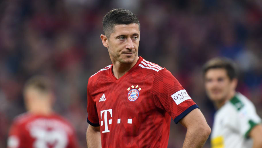 Bayern Munich's Polish forward Robert Lewandowski reacts during the German first division Bundesliga football match FC Bayern Munich vs Borussia Moenchengladbach in Munich, southern Germany, on October 6, 2018. (Photo by Christof STACHE / AFP) / RESTRICTIONS: DFL REGULATIONS PROHIBIT ANY USE OF PHOTOGRAPHS AS IMAGE SEQUENCES AND/OR QUASI-VIDEO        (Photo credit should read CHRISTOF STACHE/AFP/Getty Images)