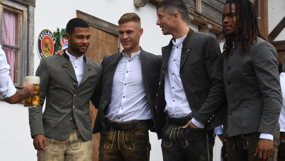 (L-R) Bayern Munich's midfielder Serge Gnabry, Bayern Munich's midfielder Joshua Kimmich, Bayern Munich's Polish forward Robert Lewandowski and Bayern Munich's Portuguese midfielder Renato Sanches wear traditional Bavarian Lederhosen (leather trousers) dresses as they arrive for the annual visit of the German first division Bundesliga football team at the Oktoberfest beer festival in Munich, southern Germany, on October 7, 2018. (Photo by Christof STACHE / AFP)        (Photo credit should read CHRISTOF STACHE/AFP/Getty Images)