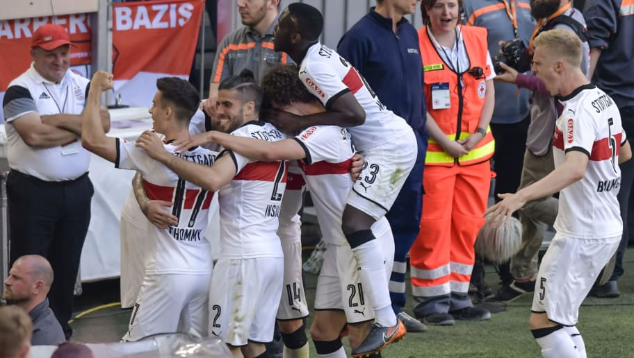 Stuttgart's German forward Daniel Ginczek celebrates the forth goal with teammates during the German first division Bundesliga football match FC Bayern Munich vs VfB Stuttgart in Munich, southern Germany, on May 12, 2018. (Photo by Guenter SCHIFFMANN / AFP) / RESTRICTIONS: DURING MATCH TIME: DFL RULES TO LIMIT THE ONLINE USAGE TO 15 PICTURES PER MATCH AND FORBID IMAGE SEQUENCES TO SIMULATE VIDEO. == RESTRICTED TO EDITORIAL USE == FOR FURTHER QUERIES PLEASE CONTACT DFL DIRECTLY AT + 49 69 650050        (Photo credit should read GUENTER SCHIFFMANN/AFP/Getty Images)