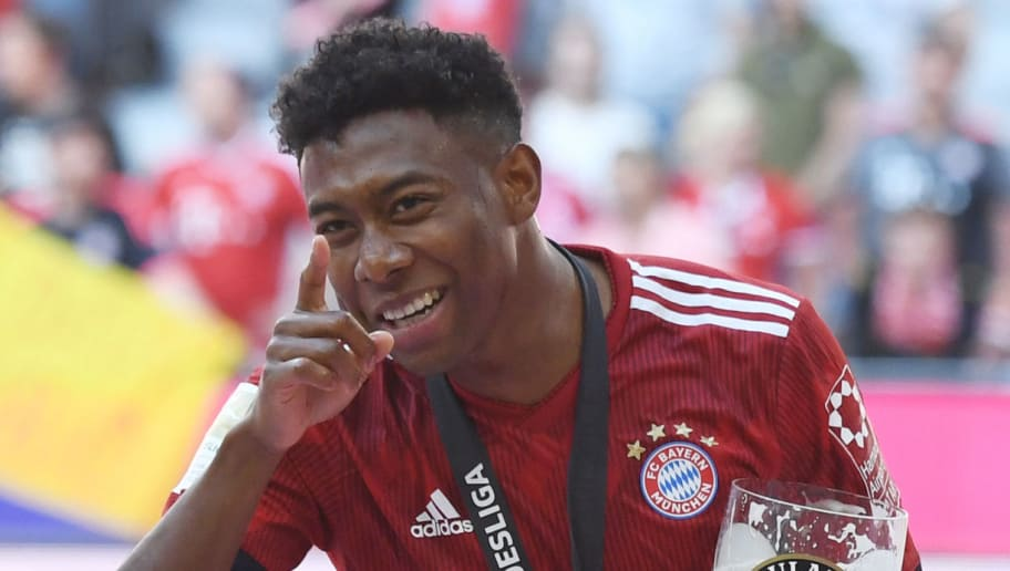 Bayern Munich's Austrian defender David Alaba walks with a beer glass during the celebration for the 28th German football championship after the German first division Bundesliga football match FC Bayern Munich vs VfB Stuttgart in Munich, southern Germany, on May 12, 2018. (Photo by Christof STACHE / AFP) / RESTRICTIONS: DURING MATCH TIME: DFL RULES TO LIMIT THE ONLINE USAGE TO 15 PICTURES PER MATCH AND FORBID IMAGE SEQUENCES TO SIMULATE VIDEO. == RESTRICTED TO EDITORIAL USE == FOR FURTHER QUERIES PLEASE CONTACT DFL DIRECTLY AT + 49 69 650050        (Photo credit should read CHRISTOF STACHE/AFP/Getty Images)