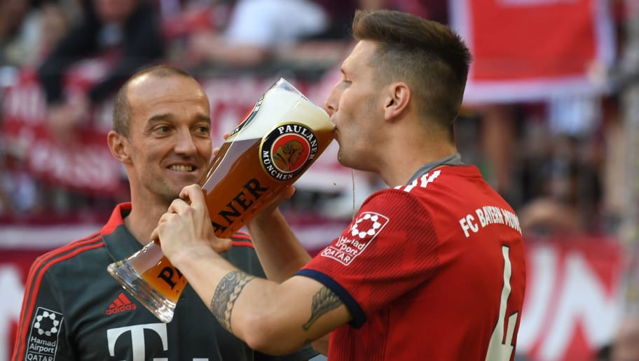 Bayern Munich's German defender Niklas Suele takes a sip of beer during the celebrations at the end of the German first division Bundesliga football match FC Bayern Munich vs VfB Stuttgart in Munich, southern Germany, on May 12, 2018. (Photo by Christof STACHE / AFP) / RESTRICTIONS: DURING MATCH TIME: DFL RULES TO LIMIT THE ONLINE USAGE TO 15 PICTURES PER MATCH AND FORBID IMAGE SEQUENCES TO SIMULATE VIDEO. == RESTRICTED TO EDITORIAL USE == FOR FURTHER QUERIES PLEASE CONTACT DFL DIRECTLY AT + 49 69 650050        (Photo credit should read CHRISTOF STACHE/AFP/Getty Images)