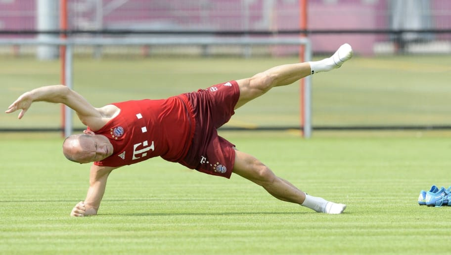 Bayern Munich's Dutch midfielder Arjen Robben stretchs alone after a training session of the German first division Bundesliga football team FC Bayern Munich at the team club area in Munich, southern Germany, on July 6, 2015. AFP PHOTO / CHRISTOF STACHE        (Photo credit should read CHRISTOF STACHE/AFP/Getty Images)